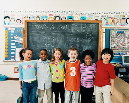school group in front of blackboard
